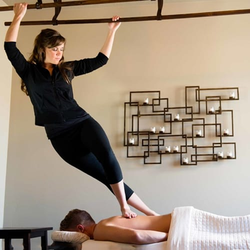 Woman performing Ashiatsu Massage